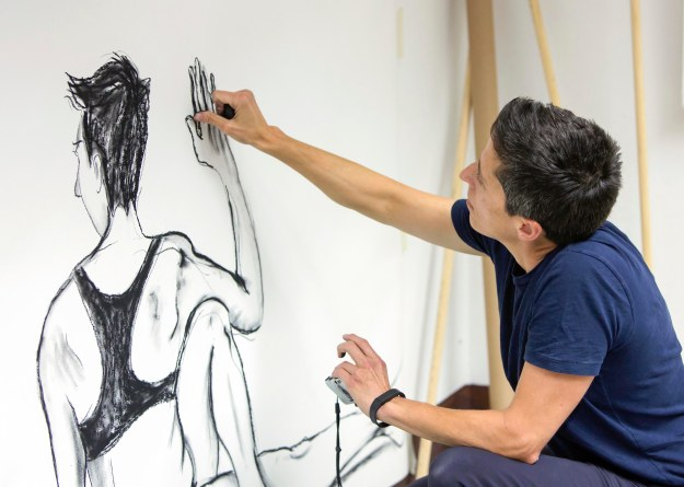 U.S. cartoonist Alison Bechdel portrayed as she works in her studio at the castle of Civitella Ranieri, central Italy, Tuesday, Sept. 2, 2014, courtesy of the John D. & Catherine T. MacArthur Foundation.